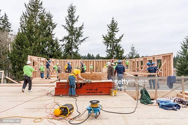 Volunteers build homeless women and children shelter