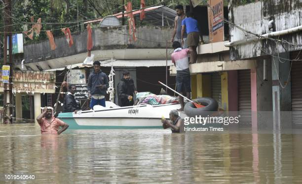 Volunteers carry flood relief materials water food and medicine for local residents at Pandanad in Chengannur Taluk on August 19 2018 in Alappuzha...