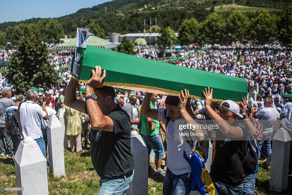 Volunteers carry some of the 136 coffins newly-identified victims of the 1995 Srebrenica massacre to their graves during the 20th anniversary of the massacre at the Potocari cemetery and memorial on July 11, 2015 in Srebrenica, Bosnia and Herzegovina. At least 8300 Bosnian Muslim men and boys who had sought safe heaven at the U.N.-protected enclave at Srebrenica were killed by members of the Republic of Serbia (Republika Srpska) army under the leadership of General Ratko Mladic, who is currently facing charges of war crimes at The Hague, during the Bosnian war in 1995.