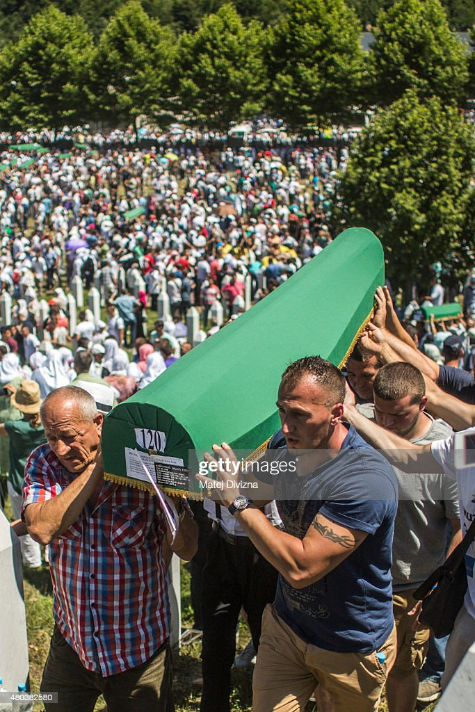 Volunteers carry some of the 136 coffins newly-identified victims of the 1995 Srebrenica massacre to their graves during the 20th anniversary of the massacre at the Potocari cemetery and memorial on July 11, 2015 in Srebrenica, Bosnia and Herzegovina. At least 8,3000 Bosnian Muslim men and boys who had sought safe heaven at the U.N.-protected enclave at Srebrenica were killed by members of the Republic of Serbia (Republika Srpska) army under the leadership of General Ratko Mladic, who is currently facing charges of war crimes at The Hague, during the Bosnian war in 1995.