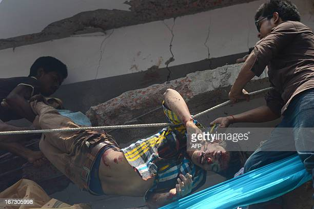 Volunteers carry the dead body of a garment worker after an eight-storey building collapsed in Savar, on the outskirts of Dhaka, on April 24, 2013....