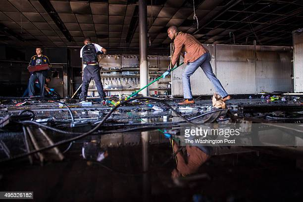 Volunteers clean a CVS pharmacy that was looted and burnt the day before as protestors for Freddie Gray protest around the city in Baltimore MD on...