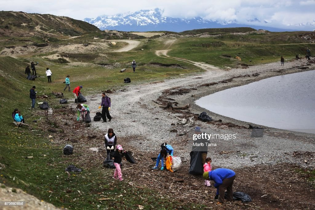 Volunteers clean trash washed up on the edge of a bay on November 11, 2017 in Ushuaia, Argentina. Ushuaia is situated along the southern edge of Tierra del Fuego, in the Patagonia region, and is commonly known as the 'southernmost city in the world'. The city's main fresh water supply comes from the retreating Martial Glacier, which may be at risk of disappearing. In a 2015 report, warming temperatures led to the loss of 20 percent of the mass and surface of glaciers in Argentina over the previous 50 years, according to Argentina's Institute of Nivology, Glaciology and Environmental Sciences (IANIGLIA). Ushuaia and surrounding Tierra del Fuego face other environmental challenges including a population boom leading to housing challenges following an incentivized program attracting workers from around Argentina. Population in the region increased 11-fold between 1970 and 2015 to around 150,000. An influx of cruise ship tourists and crew, many on their way to Antarctica, has also led to increased waste and pollution in the area sometimes referred to as 'the end of the world'.