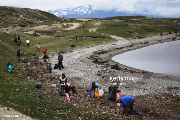 Volunteers clean trash washed up on the edge of a bay on November 11 2017 in Ushuaia Argentina Ushuaia is situated along the southern edge of Tierra...