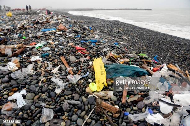 Volunteers clean up plastic waste on a beach in Lima during the World Environment Day on June 5 2018 The UN urged to take steps against the use of...