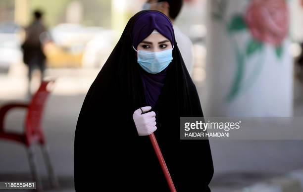 TOPSHOT Volunteers clean up the streets of the central city of Najaf on December 5 2019 following antigovernment protests The protest movement is...
