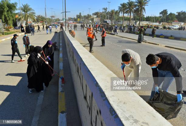 Volunteers clean up the streets of the central city of Najaf on December 5 2019 following antigovernment protests The protest movement is Iraq's...