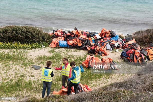 Volunteers cleaning Greek Island beach after refugee landings