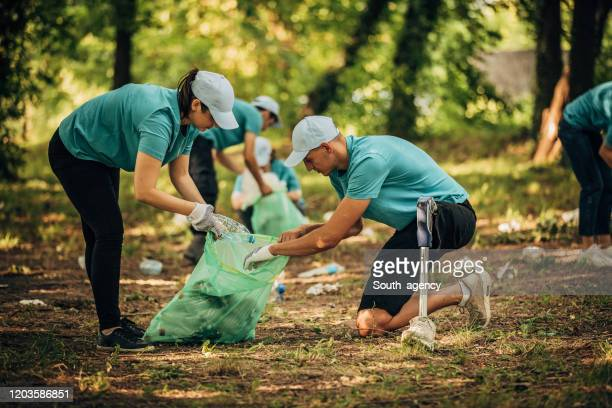 volunteers cleaning  park - disability collection stock pictures, royalty-free photos & images