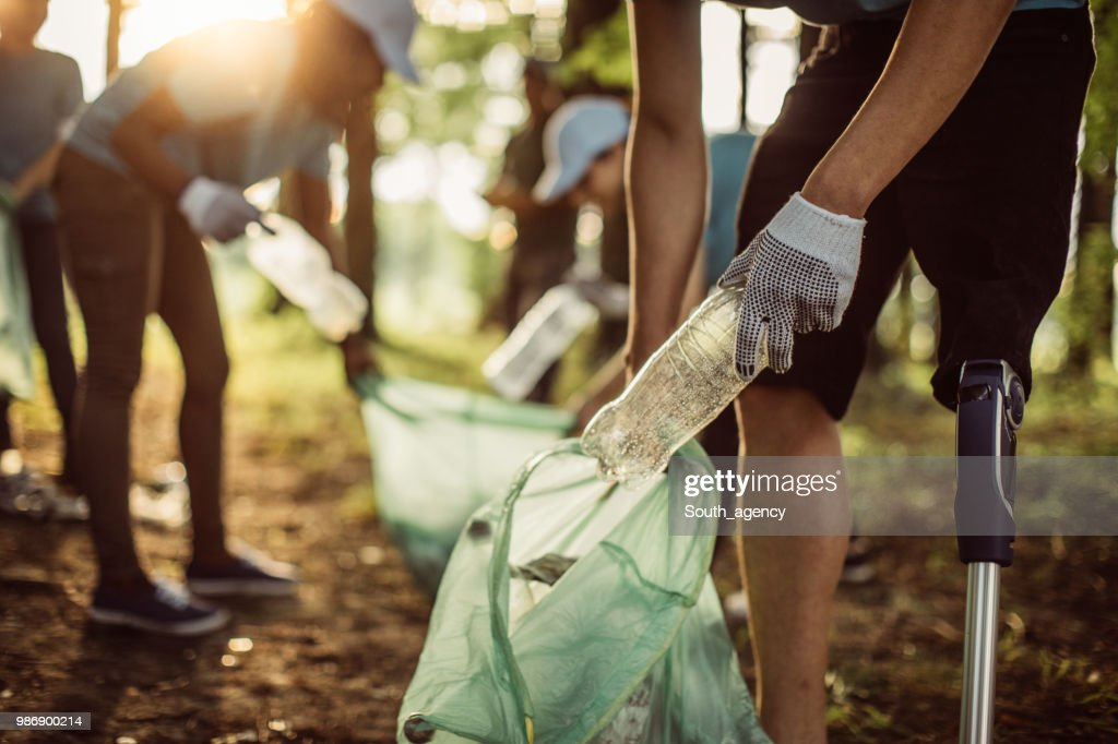Volunteers cleaning park : Stock Photo