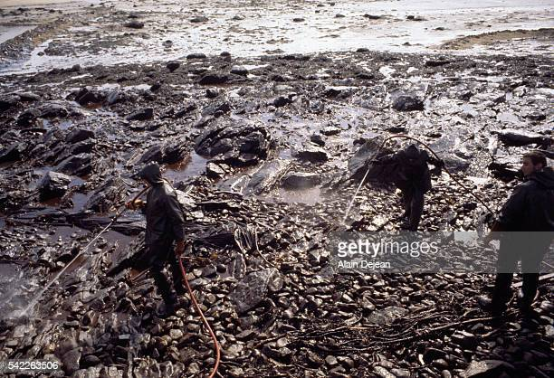Volunteers cleaning up oil, spread by high winds, after the Amoco Cadiz disaster. The supertanker Amoco Cadiz ran aground off the coast of Brittany...
