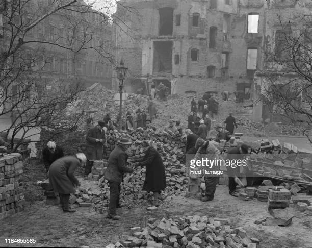 Volunteers clearing away the rubble in Dresden, in the Russian-occupied zone of Germany, after the destruction of World War II, March 1946.