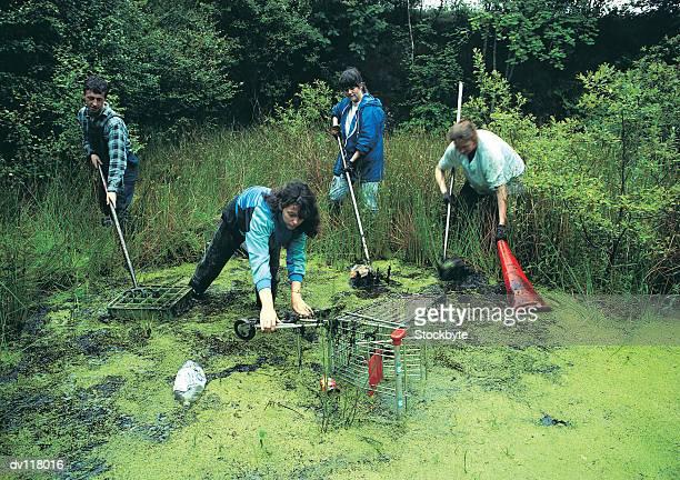 Volunteers clearing pond,Glasgow,Scotland