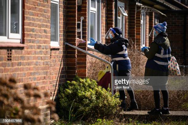 Volunteers collect Covid-19 test kits from residents in a targeted postcode near Muswell Hill on March 22, 2021 in London, England. Over the weekend,...