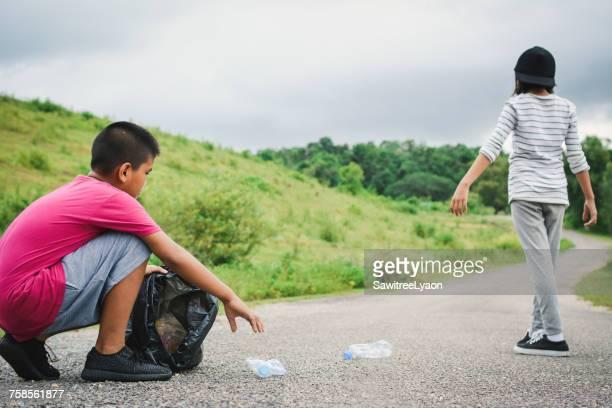 Volunteers Collecting Garbage On Road