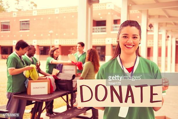 volunteers: college students collect clothing donations for community. - emergency management stock pictures, royalty-free photos & images