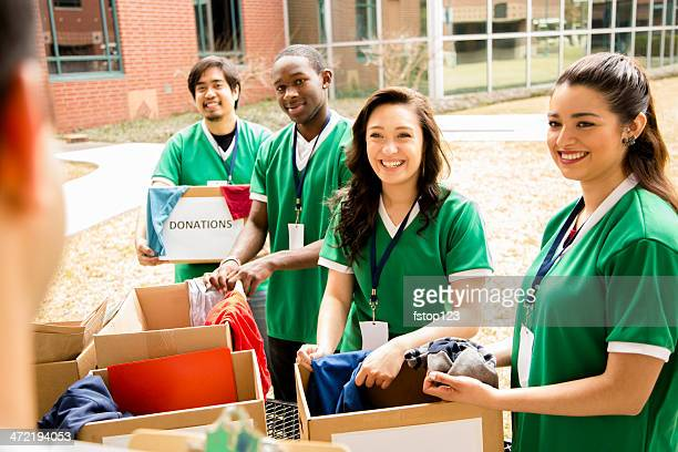 volunteers: college students collect clothing donations for community. - organised group stock pictures, royalty-free photos & images