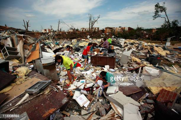 Volunteers comb through the rubble of Alberta Elementary School on May 1, 2011 in Tuscaloosa, Alabama. Alabama, the hardest-hit of six states, is...