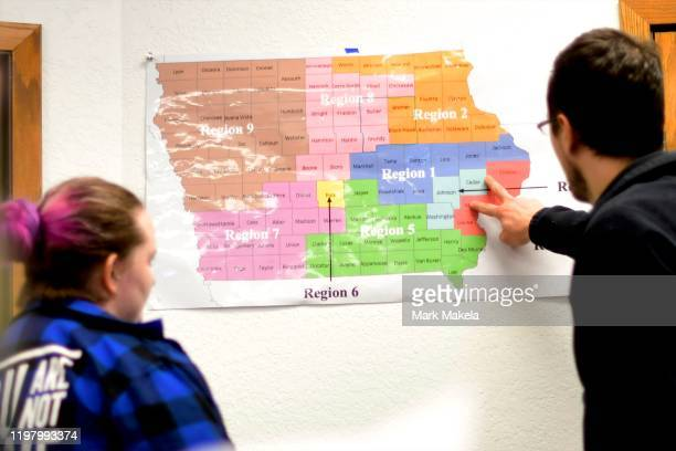 Volunteers consult a map of Iowa with divided target voter zones at a field office for Democratic Presidential candidate Bernie Sanders on February...