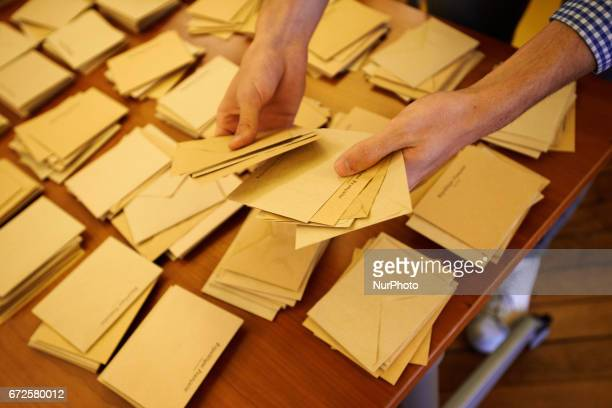 Volunteers count the ballots at the end of the first round of the French presidential election first round vote in Toulouse, France on April 23,...