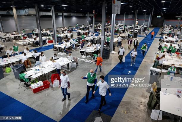 Volunteers count the votes for the parliamentary elections at candidate level in De Jaarbeurs in Utrecht on Mach 18 2021. - Dutch Prime Minister Mark...