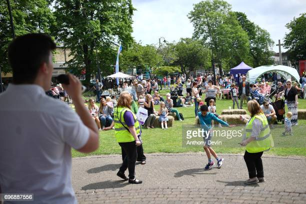 Volunteers dance as people attend a Great Get Together event in memory of murdered MP Jo Cox on June 17 2017 in Heckmondwike England More than 100000...