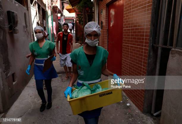 Volunteers delievery packs of food to residents in Paraisopolis favela on March 24 2020 in Sao Paulo Brazil Paraisopolis is the second largest favela...