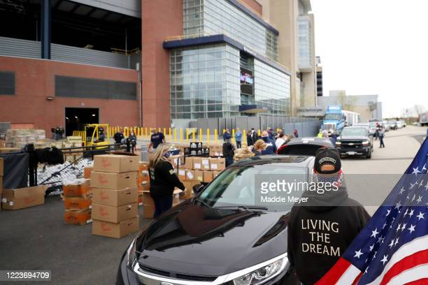 Volunteers deliver boxes of foods to families as part of the SoupR Bowl at Gillette Stadium on May 08 2020 in Foxborough Massachusetts The Patriots...