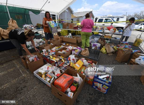 Volunteers deliver food aid to a distribution point after Hurricane Harvey caused widespread destruction in Rockport Texas on September 1 2017 / AFP...
