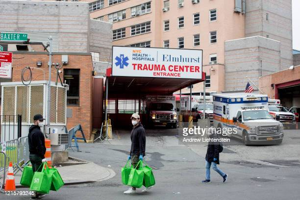 Volunteers deliver meals to an overworked hospital staff at Elmhurst Hospital on March 30 2020 in Queens New York