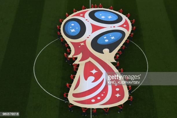 TOPSHOT Volunteers deploy a giant flag shapped as a trophy during the Russia 2018 World Cup Group D football match between Argentina and Croatia at...