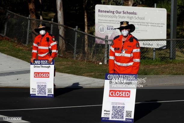 Volunteers direct traffic at a Covid-19 drive-through testing clinic in eastern Brisbane on July 31 as Australia's third-largest city Brisbane and...