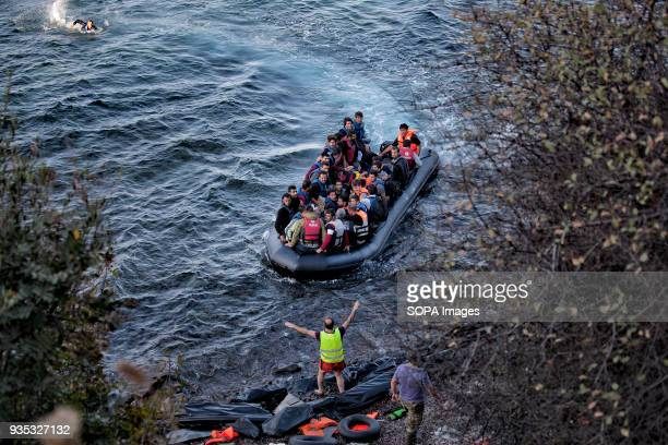 Volunteers directing a boat full of asylumseekers into shore during stormy weather In 2015 more than a million immigrants arrived in Europe by sea...