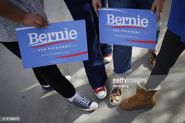 Volunteers display campaign signs for a photograph outside a campaign event for Senator Bernie Sanders an independent from Vermont and 2016...