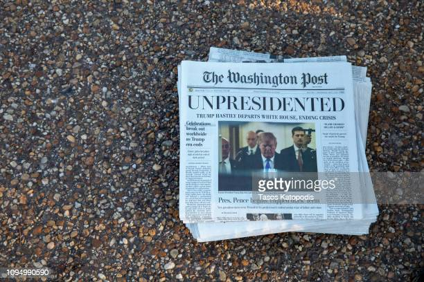 Volunteers distribute a lookalike special edition of The Washington Post date May 1 which predicts Trump leaving office after months of womenled...