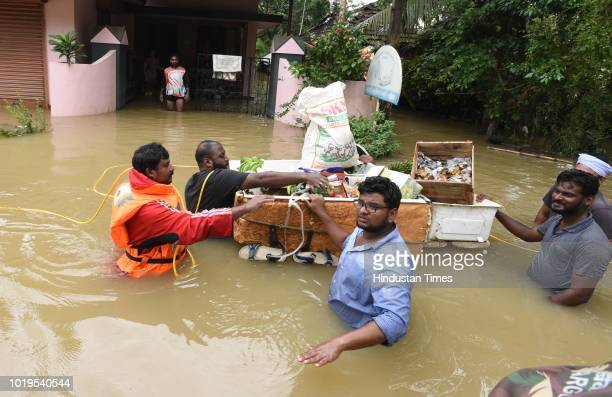 Volunteers distribute flood relief materials water food and medicine to local residents at Pandanad in Chengannur Taluk on August 19 2018 in...