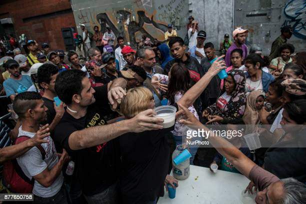 Volunteers distribute food to venezuelan people in Caracas Venezula on 23 November 2017 Venezuel people lives between the alert crisis and...
