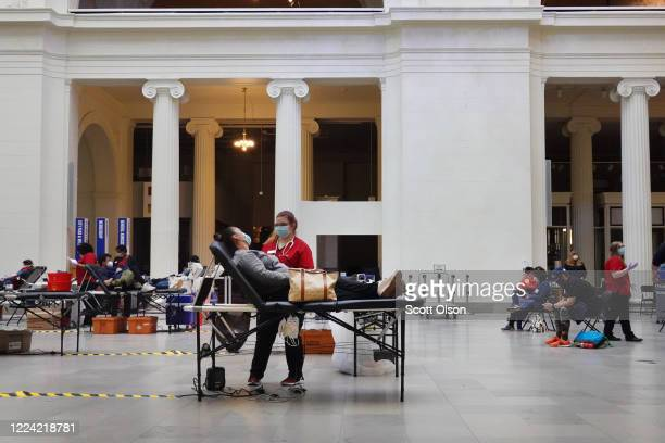 Volunteers donate blood during an American Red Cross blood drive held at the Field Museum of Natural History on May 11, 2020 in Chicago, Illinois. In...