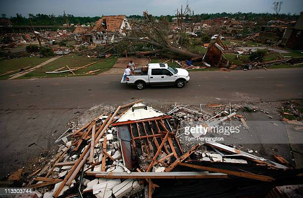 Volunteers drive through a destroyed neighborhood in an effort to distribute relief supplies to residents on May 1, 2011 in Tuscaloosa, Alabama....