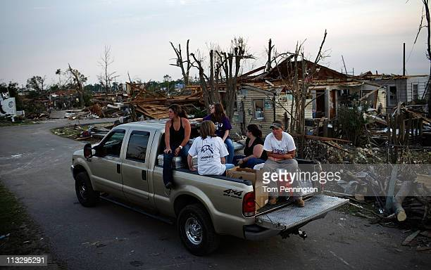 Volunteers drive through destroyed homes handing out food and water on April 30, 2011 in Tuscaloosa, Alabama. Alabama, the hardest-hit of six states,...