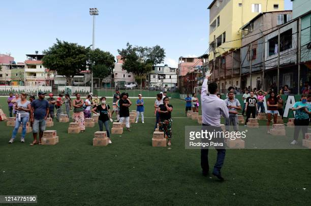 Volunteers during training session before delivering free food to residents of Paraisópolis favela on March 24 2020 in Sao Paulo Brazil Paraisopolis...