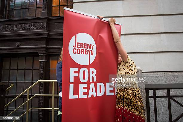 Volunteers erect a banner outside a launch of policy ideas for young people for supporters of Jeremy Corbyn for the Labour Party leadership at All...