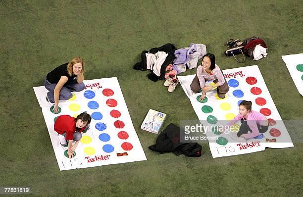 Volunteers fail in an attempt to break the World Twister record for largest game of 4160 people at the Rogers Centre November 9 2007 in Toronto...