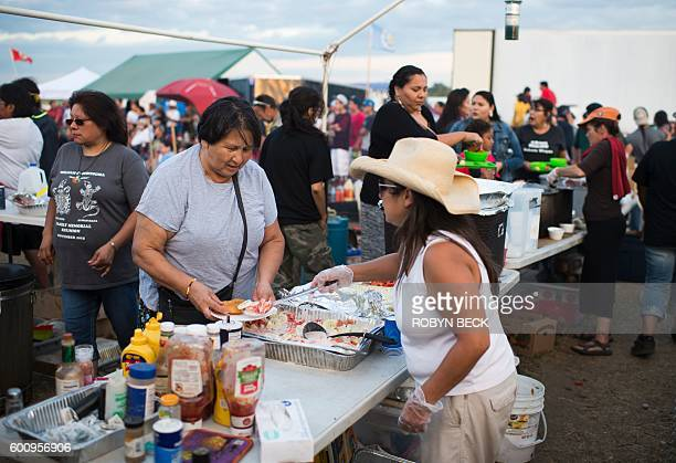 Volunteers feed campers in the main kitchen area of the Standing Rock Sioux protest encampment near Cannon Ball North Dakota where members of the...