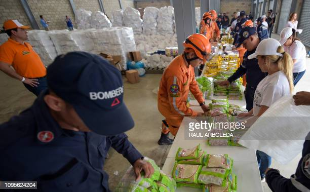 Volunteers firefighters and civil defense officers arrange US humanitarian aid goods in Cucuta Colombia on the border with Tachira Venezuela on...
