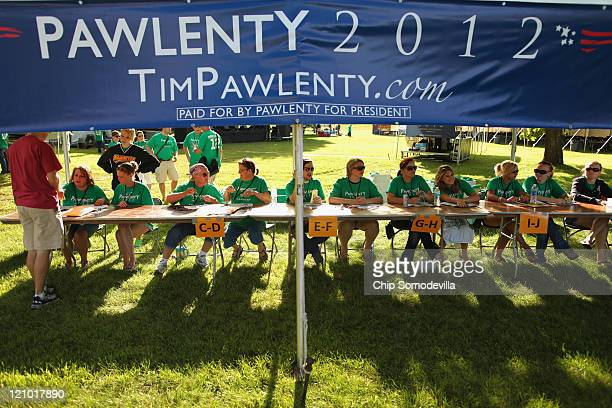 Volunteers for former Minnesota Governor Tim Pawlenty's presidential campaign wait to sing up supporters outside the Hilton Coliseum where Iowans...