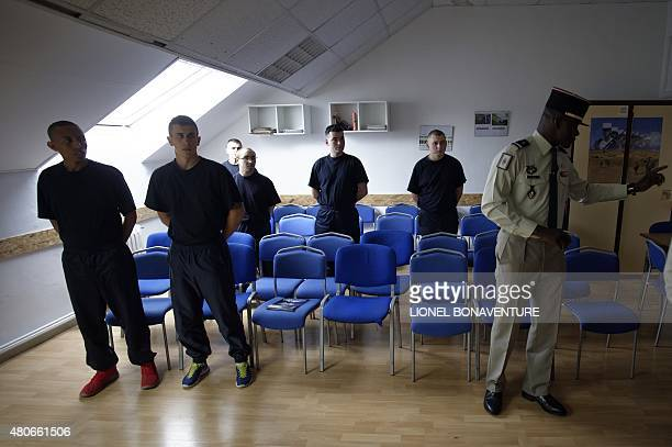 MOUTOT Volunteers for French Foreign Legion wait in a room at the recruitment center in Fontenaysousbois outside Paris on June 22 2015 Thousands of...