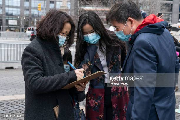 Volunteers for NYC mayoral candidate Andrew Yang help collecting signatures to get on the ballot for Democratic party primary election on Columbus...
