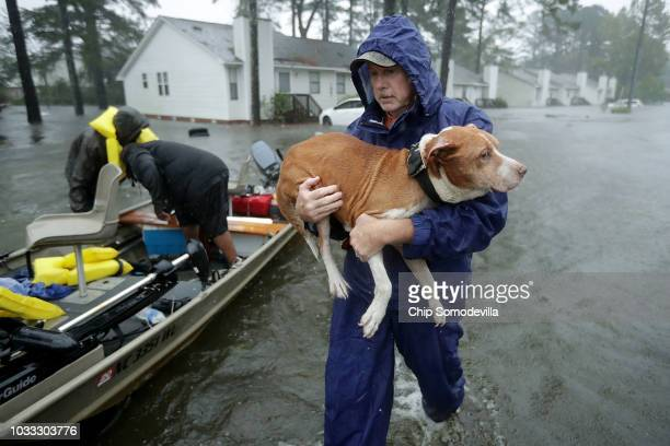 Volunteers from all over North Carolina help rescue residents and their pets from their flooded homes during Hurricane Florence September 14 2018 in...