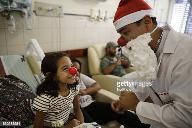 Volunteers from an NGO called quotDoutores Palhaçosquot pay a Christmas visit to deliver children's gifts to the Children's Hospital of Vila Velha...